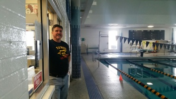 Matt Lohsl poses outside his old swim office