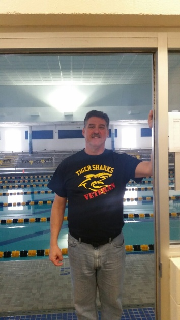 Matt Lohsl poses outside his old swim office